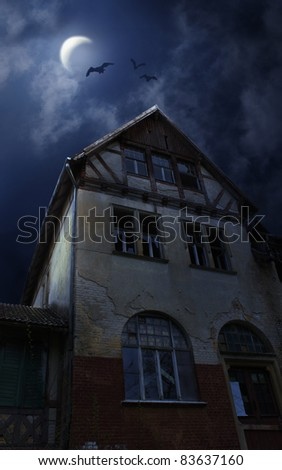 Old ruined sinister house in Halloween night. Bats flying in the sky with Moon and clouds - stock photo