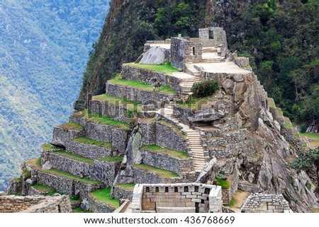 old ruins and terraces in Machu Picchu - stock photo