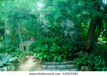 Old ruins in a forest with light shining in from the sky - stock photo