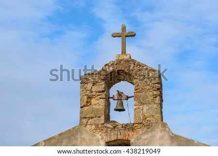 Old rural church abandoned town in Sardinia. Details of the cross and bell. / Rural Country Church. - stock photo