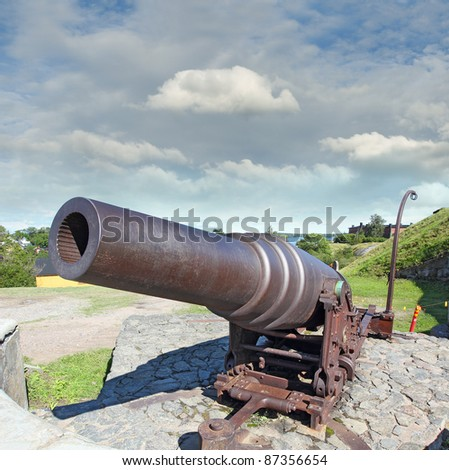 Old Russian Cannon in Suomenlinna, Sveaborg, Helsinki, Finland - UNESCO World Heritage Site - stock photo