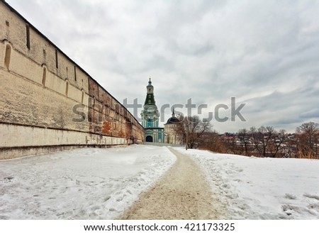 Old russian church in gloomy weather. The area of the largest monastery of the Russian Orthodox Church with a long history. Located in the center of Sergiev Posad, Moscow Region - stock photo