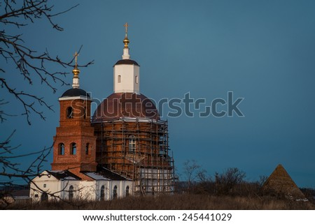 Old Russian church in the ruined fortress. Russia, the city of Eagle Village Saburovo - stock photo