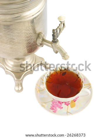 Old russian tea samovar and cup of tea isolated