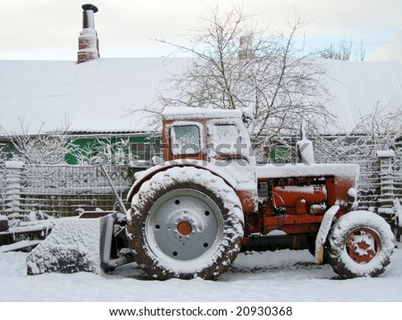 Old russian tractor, cowered with first snow