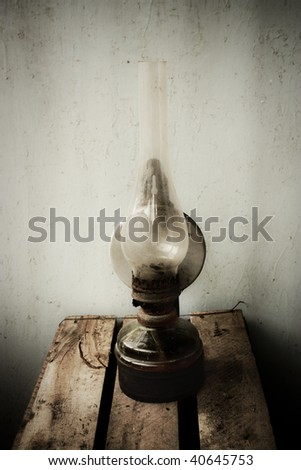 Old rust oil lamp - stock photo