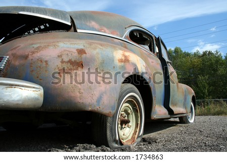 Old rusted car - stock photo