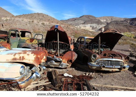 Old rusted cars in junk yard . National park Death valley - stock photo