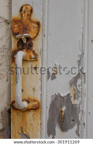 Old rusted door lock - stock photo