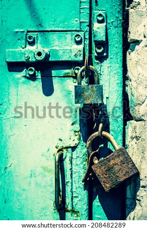 Old rusted garage padlock  - stock photo