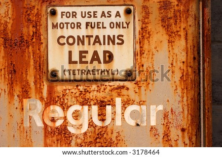 old rusted gas pump - stock photo