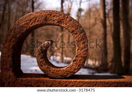 old rusted iron gate with winter snow - stock photo