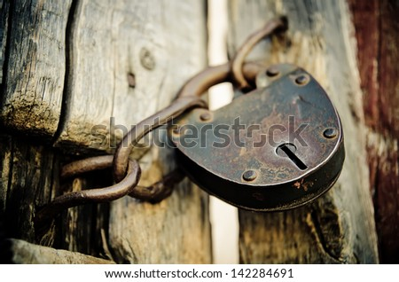 old rusted lock on a door - stock photo