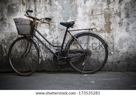 Old rustic bicyle - stock photo