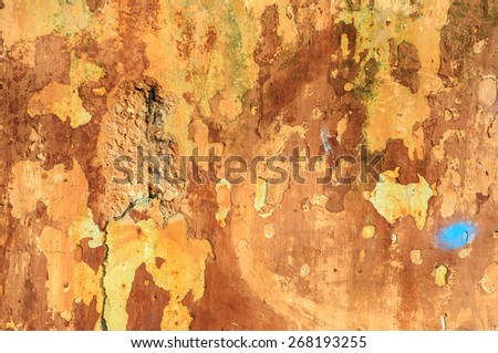 Old rustic brick wall with cracked paint and stucco