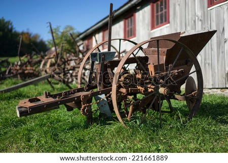 Old rustic farm equipment - stock photo