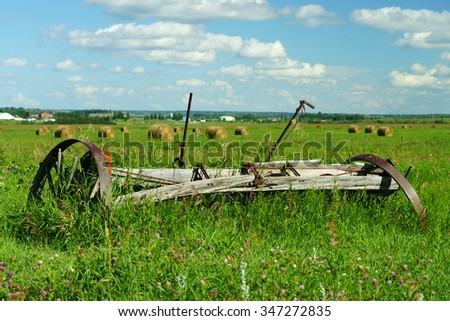 old rustic farm equipment in the field.