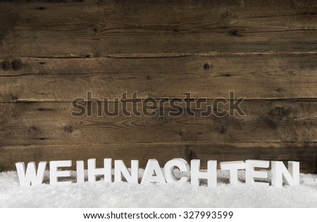 Old rustic wooden background with white german letters for Christmas. - stock photo