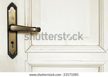 Old rustic wooden white door detail with door handle - stock photo