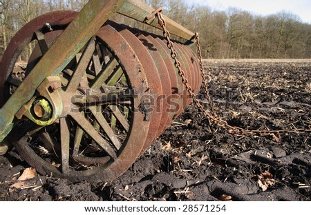Old rusty agricultural equipment - stock photo