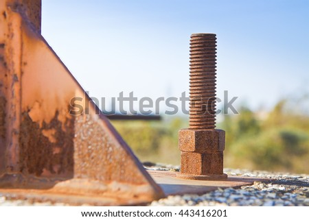 Old rusty anchor bolt with iron plate - image with copy space - stock photo
