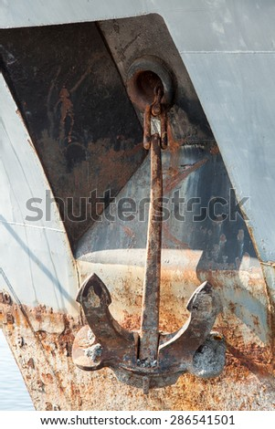 old rusty anchor on old ship - stock photo