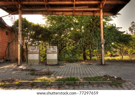 Old, rusty and abandoned gas station against nature - stock photo