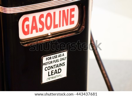 old rusty and vintage gasoline pump, background for petrol and gasoline industry concept - stock photo