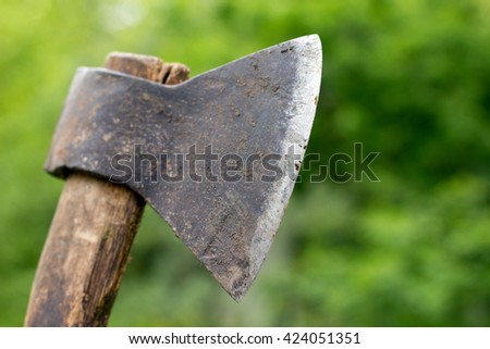 old rusty ax a long time served - stock photo