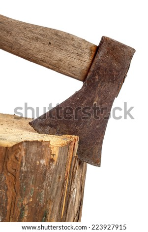 Old rusty axe stuck in log isolated over white
