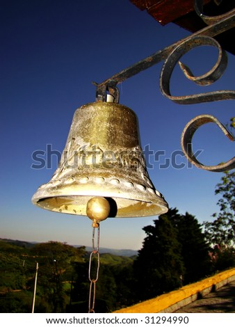 old rusty bell over beautiful blue sky