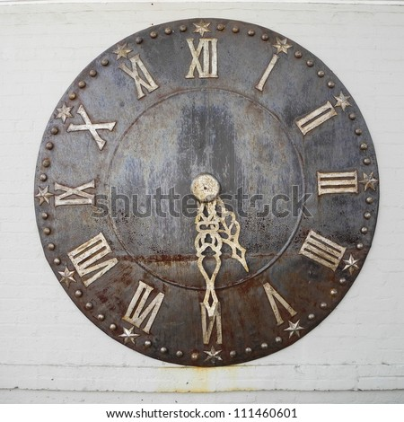 Old rusty big street clock on wall of the building - stock photo