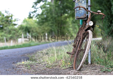 old rusty bike - stock photo