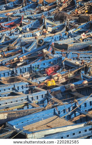 Old rusty blue painted fishing boats in the port of Essaouira, Morocco