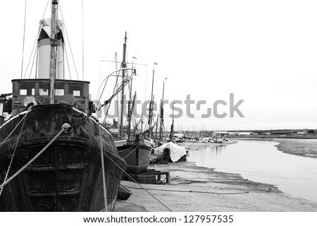 old rusty boats moored up - stock photo