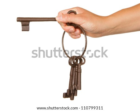 Old rusty bunch of keys in hand, isolated on white - stock photo