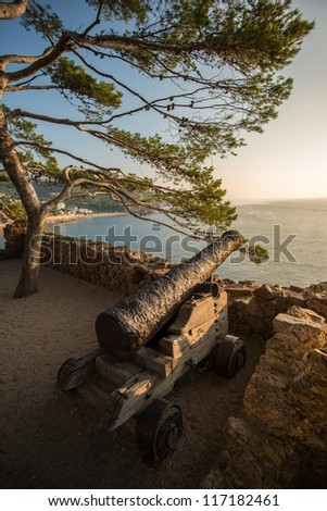 Old rusty cannon at Tossa De Mar - stock photo