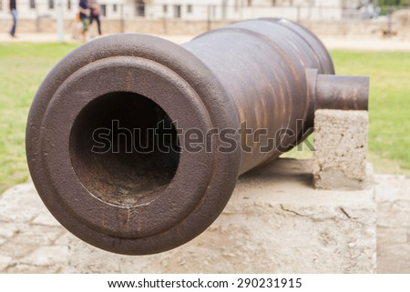 Old rusty cannon barrel in acre in north of israel - stock photo
