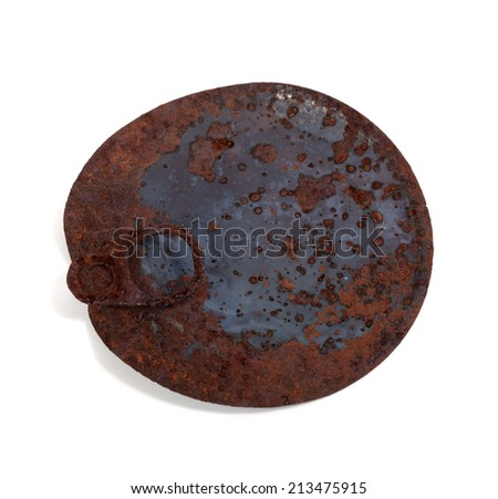 Old rusty cap of tin can isolated on white background - stock photo