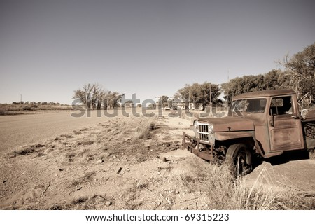Old rusty car in abandoned town along historic US Route 66, Texas - stock photo