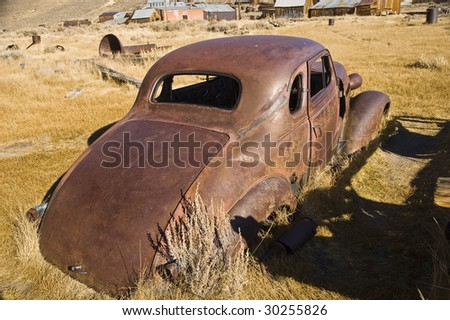 old rusty car shell in need of repair - stock photo