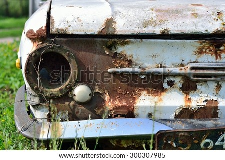 Old rusty car with round headlights - stock photo