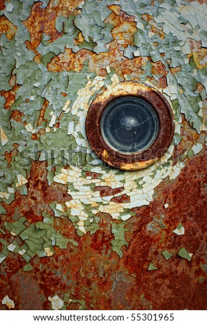 old rusty door with a spy-hole and peeling paint - stock photo