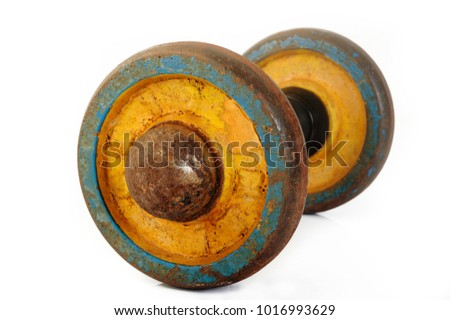 Old rusty dumbbell on white background
