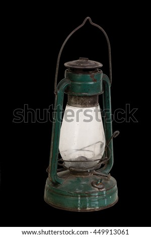 Old rusty dust lamp isolated on black. - stock photo