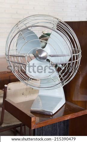 Old rusty electric fan - stock photo