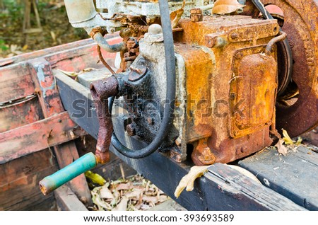 Old rusty engine on small boat