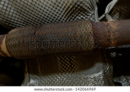 old rusty exhaust manifolds - stock photo