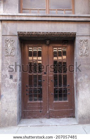 Old rusty exterior door with glass windows - stock photo