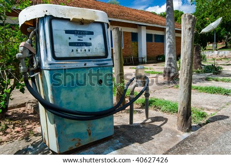 Old rusty gas pump in a Brazilian farm. - stock photo